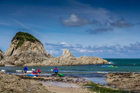 Lee Bay on the north coast of Devon. A group of kayakers are preparing to sail. England Stock Photo