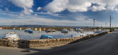 Panorama of the harbor in the small village of Cockwood on the bank of the river Exe. The tide. Devon. England