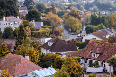 Quiet district in Torquay. Autumn morning. Hardly noticeable haze. Ilsham Road. Devon. England Stock Photo