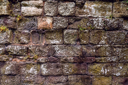 foundation cracks: The surface of the ancient Roman wall in England. Devon. Exeter