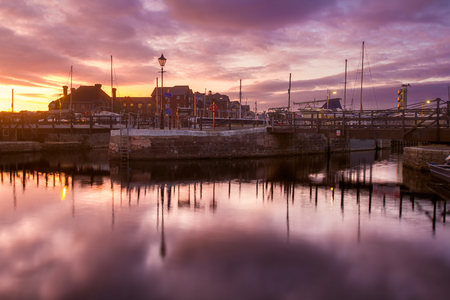 Evening in the harbor of the city of Exeter. Colorful, dramatic sunset. Devon. England