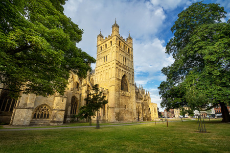 The famous Exeter Cathedral. The main attraction of the city. Early summer morning. The walls are illuminated by the low rising sun. Nobody. Exeter. Devon. England 版權商用圖片