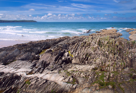 Coastal rocks visible at low tide. Beautiful coast in Woolacombe. Devon. England