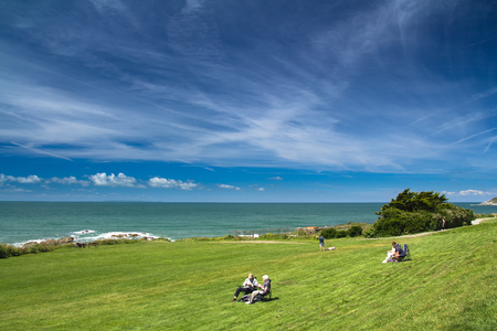 Woolacombe, Devon, England, 14 July, 2016:  People rest and enjoy the good weather