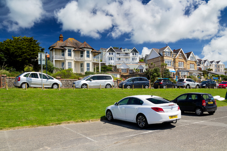 Woolacombe, Devon, England, 14 July, 2016:  Cars on the parking lot next to the beautiful houses Editorial