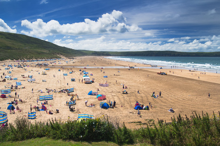 Woolacombe, Devon, England, 14 July, 2016:  Many people rest on the beach. Some play games. Someone is sunbathing or bathing. Editorial