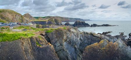 Panorama of the sea coast near Hartland Quay. You can see a car park. Devon. UK