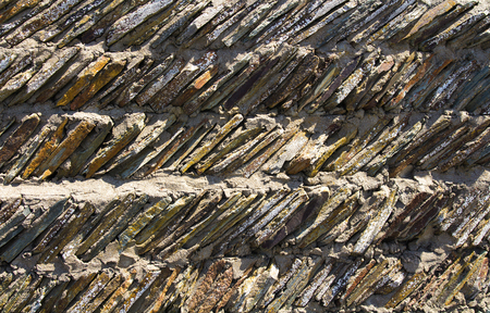 One of the original wall masonry samples or the fence in Devon. Woolacombe. England Stock Photo