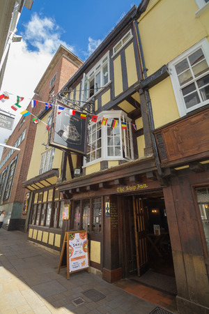 Exeter, Devon, England, 22 July 2016:  The appearance of the ancient pub Ship Inn in the center of the Exeter Editorial