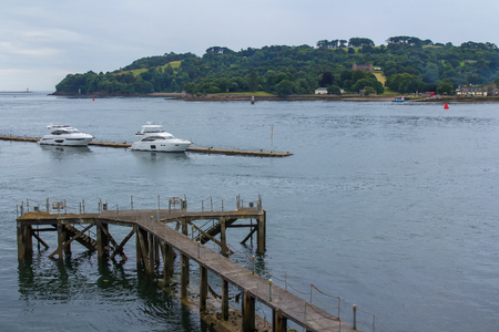 Two modern boats are moored at the pier. The Coast in Plymouth. Devon. England Stock Photo