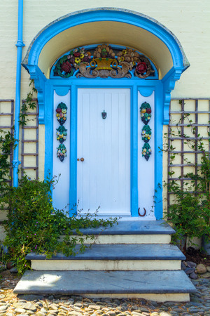 Beautiful porch, decorated with colorful stucco molding Stock Photo