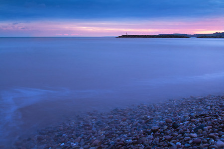 Sunset over the English Channel in the town of Sidmouth. Long exposure. Devon. UK