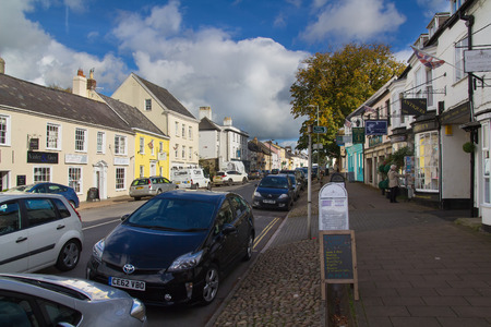 Honiton, Devon, England, 19 October 2016:  A street in Honiton. Parked cars and pavement