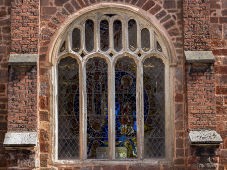 Window with a stained-glass window in the old church. Downtown Exeter. Devon. UK