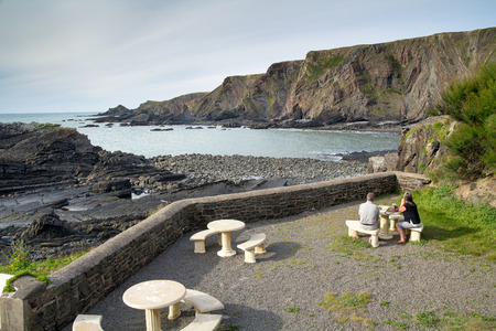 Tables of the pub in a picturesque location in Hartland Quay. Devon. England Stock Photo
