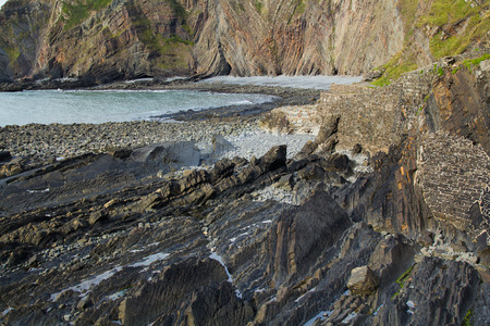 The bay at low tide and the old shore fortifications. Hartland Quay. Devon. UK