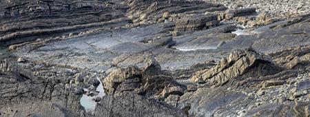 Coastal texture of rocks. Near Hartland Quay. Panorama. Devon. UK