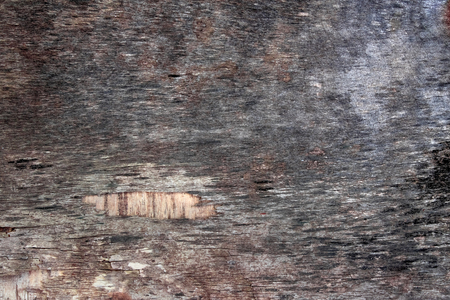 The surface of the old plywood. Grayish color. Cracked. Background Stock Photo