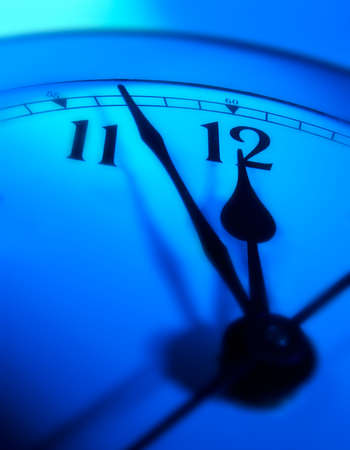 Blue clock approaching 12.