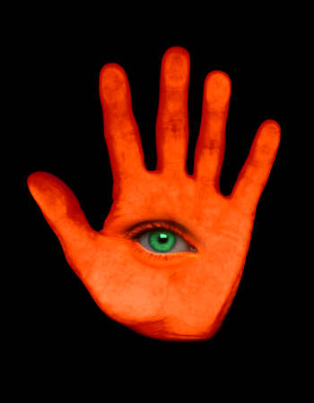 ORANGE HAND WITH GREEN EYE IN PALM Stock Photo