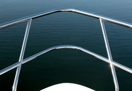 CHROME HAND RAIL ON BOW OF BOAT Banco de Imagens