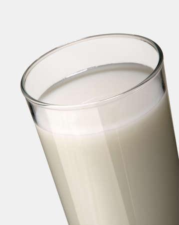 GLASS OF FRESH MILK ON WHITE BACKGROUND Фото со стока