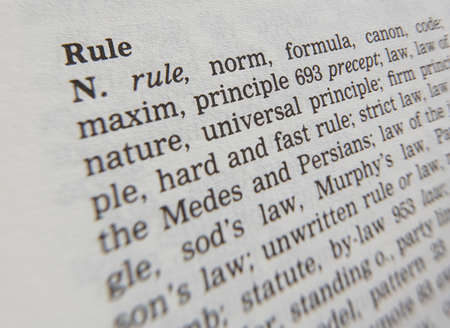 Thesaurus page showing synonyms of the word rule Фото со стока