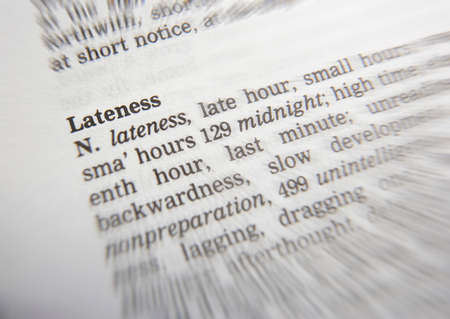 Close up of thesaurus page showing definition of the word lateness