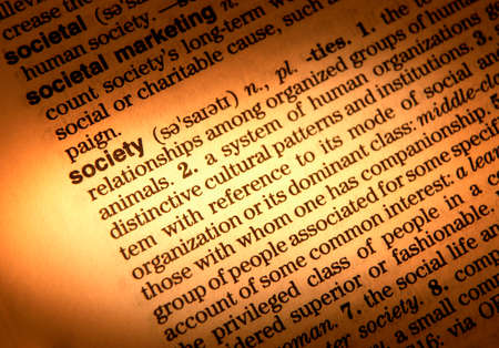 Close up of dictionary page showing definition of the word society