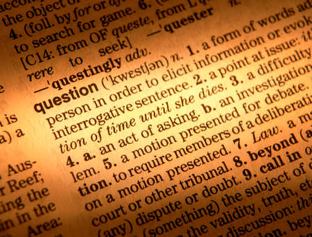 Close up of dictionary page showing definition of the word question