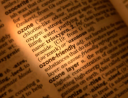 Close up of dictionary page showing definition of the word ozone Фото со стока