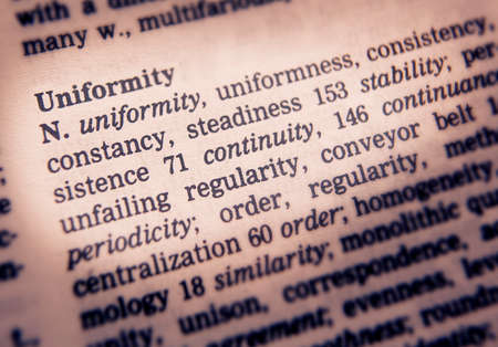 Close up of thesaurus page showing definition of the word uniformity
