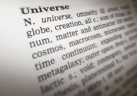 Close up of thesaurus page showing definition of the word universe