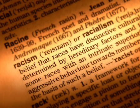 Close up of dictionary page showing definition of the word racism