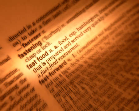 Close up of dictionary page showing definition of the term fast food