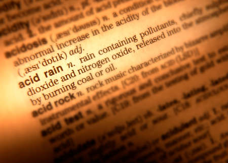 Close up of dictionary page showing definition of term acid rain