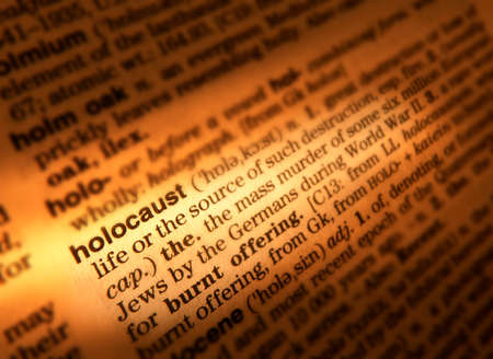 Close up of dictionary page showing definition of the word holocaust 版權商用圖片