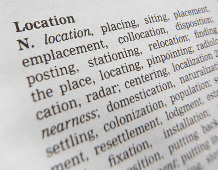 Close up of thesaurus page showing definition of the word location