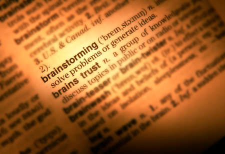 Close up of dictionary page showing definition of the word brainstorming