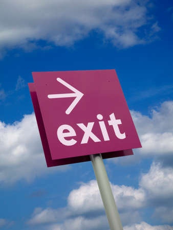 Purple exit sign isolated against blue sky and clouds background