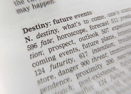 Close up of thesaurus page showing definition of the word destiny