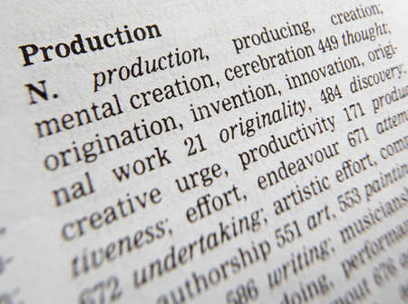 Close up of thesaurus page showing definition of the word production