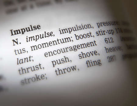 Close up of thesaurus page showing definition of the word impulse 写真素材