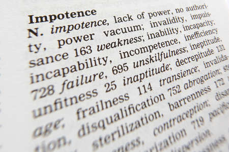 Close up of thesaurus page showing definition of the word impotence 写真素材
