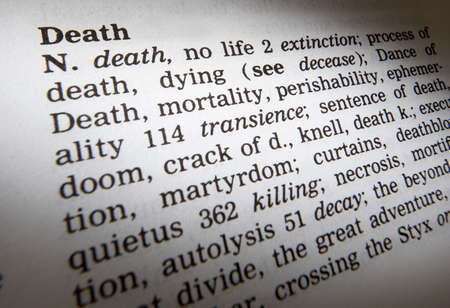Close up of thesaurus page showing definition of the word death 写真素材