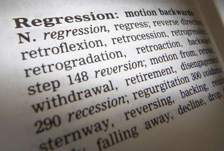 Close up of thesaurus page showing definition of the word regression