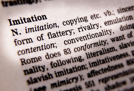 Close up of thesaurus page showing definition of the word imitation 写真素材