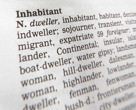 Close up of thesaurus page showing definition of the word inhabitant Imagens
