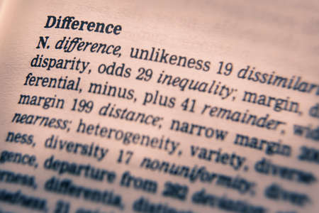 Close up o thesaurus page showing definition of the word difference