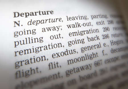 Close up of thesaurus page showing definition of the word departure